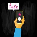 Vendita di Black Friday dello Smart Phone della tenuta della mano piana Fotografia Stock