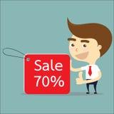 Vendita di etichetta di acquisto di manifestazione dell'uomo d'affari 70% con il pollice sul vettore Fotografie Stock Libere da Diritti