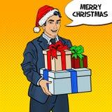 Vendita di natale Schiocco Art Man in Santa Hat con l'albero di Natale e dei regali Immagine Stock