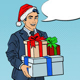 Vendita di natale Schiocco Art Man in Santa Hat con l'albero di Natale e dei regali Fotografia Stock Libera da Diritti