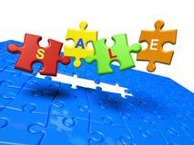 Vendita. Parti di puzzle con testo Fotografia Stock