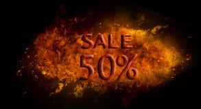 Vendita rossa 50% sull'esplosione della fiamma del fuoco, fondo nero Fotografia Stock Libera da Diritti