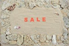 Vendita scritta in sabbia Fotografie Stock