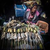 Venditore del pesce immagine stock