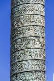 Vendome column, fragment, Paris. Vendome column with statue of Napoleon Bonaparte, on the Place Vendome, in France. Vendome column has 425 spiraling bas-relief Royalty Free Stock Photo