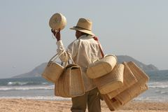 Vendor. Beach vendor selling baskets in Mazatlan, Mexico royalty free stock images