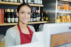 Vendor in cash register Royalty Free Stock Photo