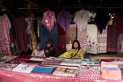 Vendor children. Sale the native cloth Stock Photos