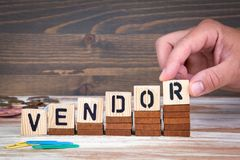 Vendor concept. Wooden letters on the office desk, informative and communication background royalty free stock photo
