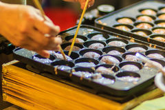 Vendor is cooking for Khanom khrok or coconut-rice pancakes, one Royalty Free Stock Photo