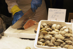 A vendor cutting fish at the Boqueria market Royalty Free Stock Photo