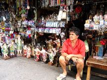 A vendor beside the famous Antipolo Church sells a wide variety of religious items. Royalty Free Stock Image