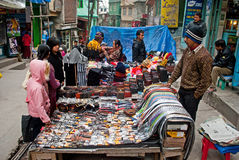 Vendor at Gangtok. A vendor is selling all sorts of diverse items including cottage cheese, incense sticks to even electronic gadgets at Lal Bazaar located below Royalty Free Stock Photography