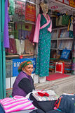 Vendor at Gangtok. A vendor is selling all sorts of diverse items including cottage cheese, incense sticks to even electronic gadgets at Lal Bazaar located below Stock Images