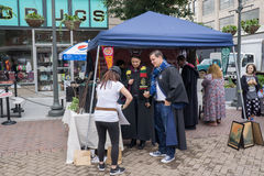 Vendor at the Harry Potter Festival. Roanoke, VA – May 13th: Festival goers making a purchase from a vendor at the Roanoke Harry Potter Festival located royalty free stock images