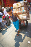 Vendor hauling boxes in Manila Stock Photography