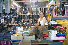Vendor at Kota Tua Market. Jakarta, Indonesia -  December 19 2009, Street vendor selling replica jeans, belt, wallet and underwears at Kota Tua, Jakarta Stock Photo