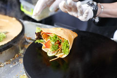 Vendor making crepe with vegetables outdoors Royalty Free Stock Photography