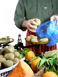 Vendor at the market. Vendor is selling potatoes at the market royalty free stock photo