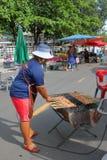 Vendor at market stall Royalty Free Stock Photography
