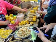 Vendor in Night Market of Thailand Selling Grilled Corn stock photo