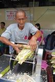 Vendor prepares fresh sugar can juice in a kiosk royalty free stock images