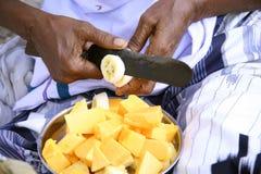 Vendor preparing fruit salad Stock Image