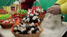 Vendor puts in bag doughy mushrooms  and gives them a woman stock video footage