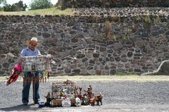 Mexico City. A vendor is seen outside of the Pyramid of the Sun at the site of Teotihuacan on March 17, 2014 in Mexico City Stock Photos