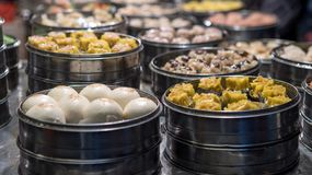 Vendor selling dumpling and shaomai in asian street food market of Taiwan royalty free stock image