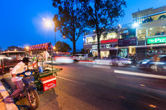 Vendor selling food at evening asian city. Phnom Penh, Cambodia Royalty Free Stock Images