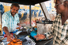 Vendor selling food in a local market. Royalty Free Stock Photos