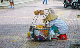 A vendor selling foods on street at Cholon in Saigon, Vietnam Royalty Free Stock Image