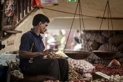 Vendor selling fresh vegetables and fruits Royalty Free Stock Images