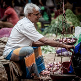 Vendor selling fresh vegetables and fruits Stock Photo