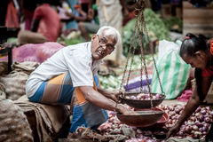 Vendor selling fresh vegetables and fruits Royalty Free Stock Photo