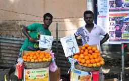 Vendor selling fresh vegetables and fruits Stock Photography