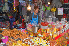 A vendor selling fried snacks and fruits related dessert at Chatuchak Weekend Market Royalty Free Stock Photography