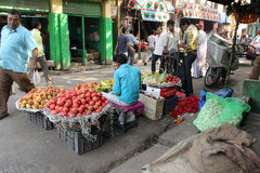 Vendor selling fruit on the open market. On November 28, 2012 in Kolkata. Only 0.81% of the Kolkata`s workforce employed in the primary sector agriculture Royalty Free Stock Image