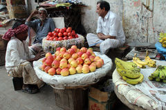 Vendor selling fruit on the open market Stock Images