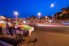 Vendor selling fruits at asian city. Phnom Penh, Camboda Royalty Free Stock Photo