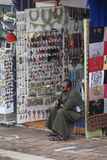 Vendor selling his wares Royalty Free Stock Images