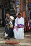 Vendor selling his wares Royalty Free Stock Photos