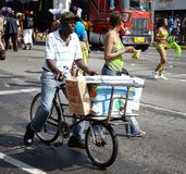 Vendor selling ice cream in a carnival, Jamaica Royalty Free Stock Photos