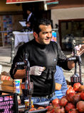 Vendor for selling pomegranate juice. This image was taken in Istanbul. This pomegranate juice is one of delicious and popular beverage and travelers are able to Stock Photos