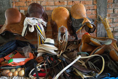 Vendor selling saddles in Colombia. September 6, 2016 Silvia, Colombia: vendor stand in the local market offering saddlery products Royalty Free Stock Photo