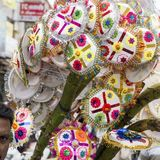 Vendor selling umbrella for devotees to bless Hindu god Ganesh at local market on the first day of Ganesh Stock Photos