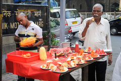 Vendor sells fruit salad in a street on Mumbai Royalty Free Stock Photo