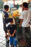 Vendor sells grilled corn, Ubud, Bali Royalty Free Stock Image