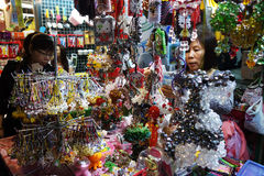 A vendor sells handphone beads jewelry in Mong Kok, Hong Kong Royalty Free Stock Photos
